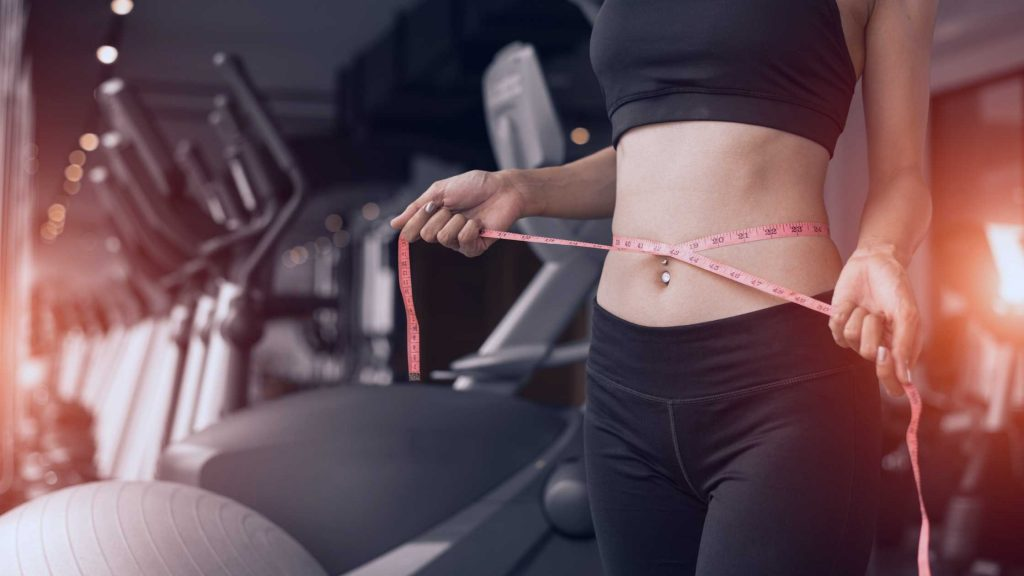woman in gym with natural weight loss NYC program