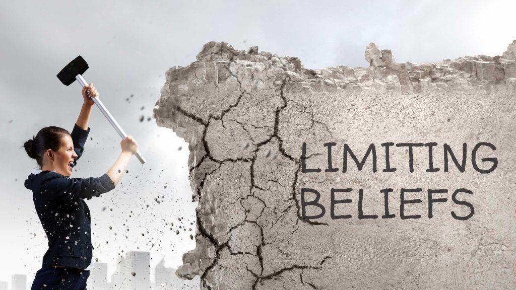 woman breaking wall like using hypnosis for breaking limiting beliefs